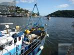 One of the Dartmouth crabbing fleet boats heading out early in the morning. 90 seconds from property