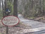 Entrance to 145 acre property with 2 upscale cottages and 1 off grid glamping cabin.