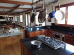Chef's kitchen is well appointed with state if the art appliances, cookware, cutlery and dishes.