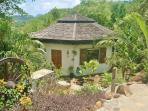 Palm Cottage is surrounded by lush tropical gardens