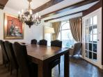 Kitchen opens to large dining table