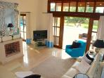 Villa 81 - Luxurious living area - beautifully furnished, leading out to the pool
