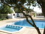Paddling and swimming pools, sun bathing terrace close to pool bar, hot tub and BBQ.