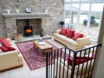 Woodpecker cottage light filled conservatory with huge fireplace and woodburning stove