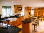 Old Stables , huge magnificent oak Mark Wilkinson designer fully equipped kitchen with Aga