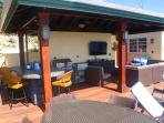 A new 1000 sq foot addition to the deck features an outdoor kitchen, living and dining areas with TV