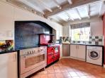 Kitchen with double electric range cooker and washing machine