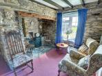 The sitting room is furnished in traditional style, with a cottage suite