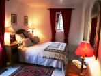 A bedroom which is downstairs in the square tower. King-size bed or 2 single beds.