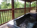 The HOT TUB is under cover on the front porch on the very private mountain side