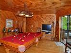 Lower Level Game Room With A Pool Table, And A 60 Game Video Arcade Table Set On Free Play.