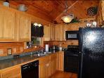 Fully Stocked Kitchen On Upper Main Level