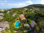 Aerial view of Baan Jasmine and its swimming pool. Beyond you can see the sea.