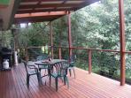 Spacious deck overlooking creek & rainforest