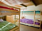 Guest room 2 on main level with twin size bunk beds