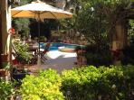 Swimming pool and jacuzzi surrounded by lush foliage in this oasis of peace and natural beauty