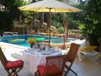 Breakfast by the pool in summer