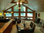 Great room view from back to front, dining for 8, piano, lounge/tv area, chess table, kitchen