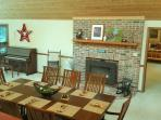 service for up to 8 by the fire!  door on the left is foyer entry, peek into Bedroom 1 on the right.