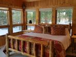 Bedroom 2, rustic log King with great views and private access to backyard.  Luxury linens & quilts
