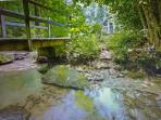 Looking across the creek toward the house, bridge provides access to both sides of the creek!