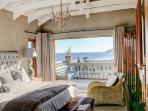 Main bedroom with seaviews. Underfloor heating. Gas fireplace. Full dstv. Kimgsize bed. Good Linen