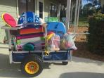 Your beach cart is PACKED with fun. Chairs, boogie boards, sand toys and more.