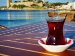 Enjoy a Turkish tea at Bodrum beach overlooking St Peters Castle.