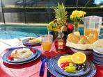 Enjoy an al fresco breakfast by the pool-melamine plateware is supplied for your safety
