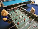 Our bears love to play foosball, air hockey or pool on the 8ft table - you will too!