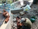 large outdoor bathtub (overlooks lake and three volcanoes) during build