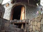 front of left side of earthship with stairs