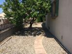 Side garden with fruit, olive and nut  trees, laundry and basement / games room access