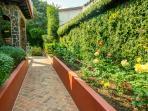 A spice garden & a rose garden greet you as you approach the house entrance.