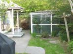 Patio outside kitchen w/ gas grill and clothesline for wet beach stuff