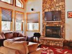 Kick back in the cozy living room and watch your favorite show on the flat screen TV above the wood burning fireplace