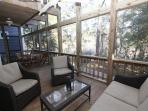 Screened Porch Seating Showing Canal View