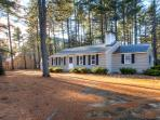 Surrounded by towering pine trees and wooded views, this home feels very peaceful and quiet.