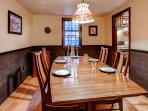 Enjoy family meals in the charming dining room.