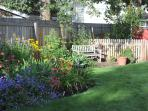 Enjoy your morning coffee or afternoon tea on the sunny garden bench.