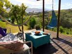 Comfortable shaded deck area with spectacular views across the valley