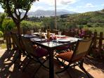 Shaded terrace for dining and relaxing, view to deck, garden, pool and valley