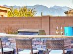 Enjoy a cold beverage while gazing out at magnificent mountain views.