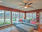 Watch beautiful sunsets over the lake from the comfort of the sunroom.