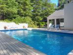 Enjoy the best of outdoor living at this exceptional East Hampton vacation rental home, which features a private...
