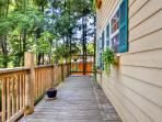 Spend countless hours admiring the beautiful scenery from the abode's private wraparound porch.
