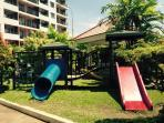 Garden next to the pool for kids to play