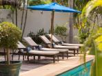 Loungers for four guests by the pool