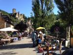 Wander around a `brocante`at Belcastel one of the most beautiful villages in France, 15 mins away.