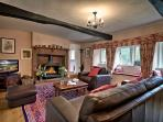 The spacious sitting room at Stag Cottage with views over the front garden and woodland.